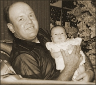 Daddy and Jann at Christmas.  Jann at 1 month old.