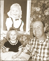 Daddy and Jann in front of the portrait he painted of me.  That portrait is priceless and oh, so cherished.